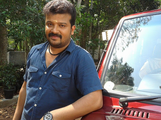 Santhosh Sasidharan as Mansijan in Flowers TV Serial Moonumani
