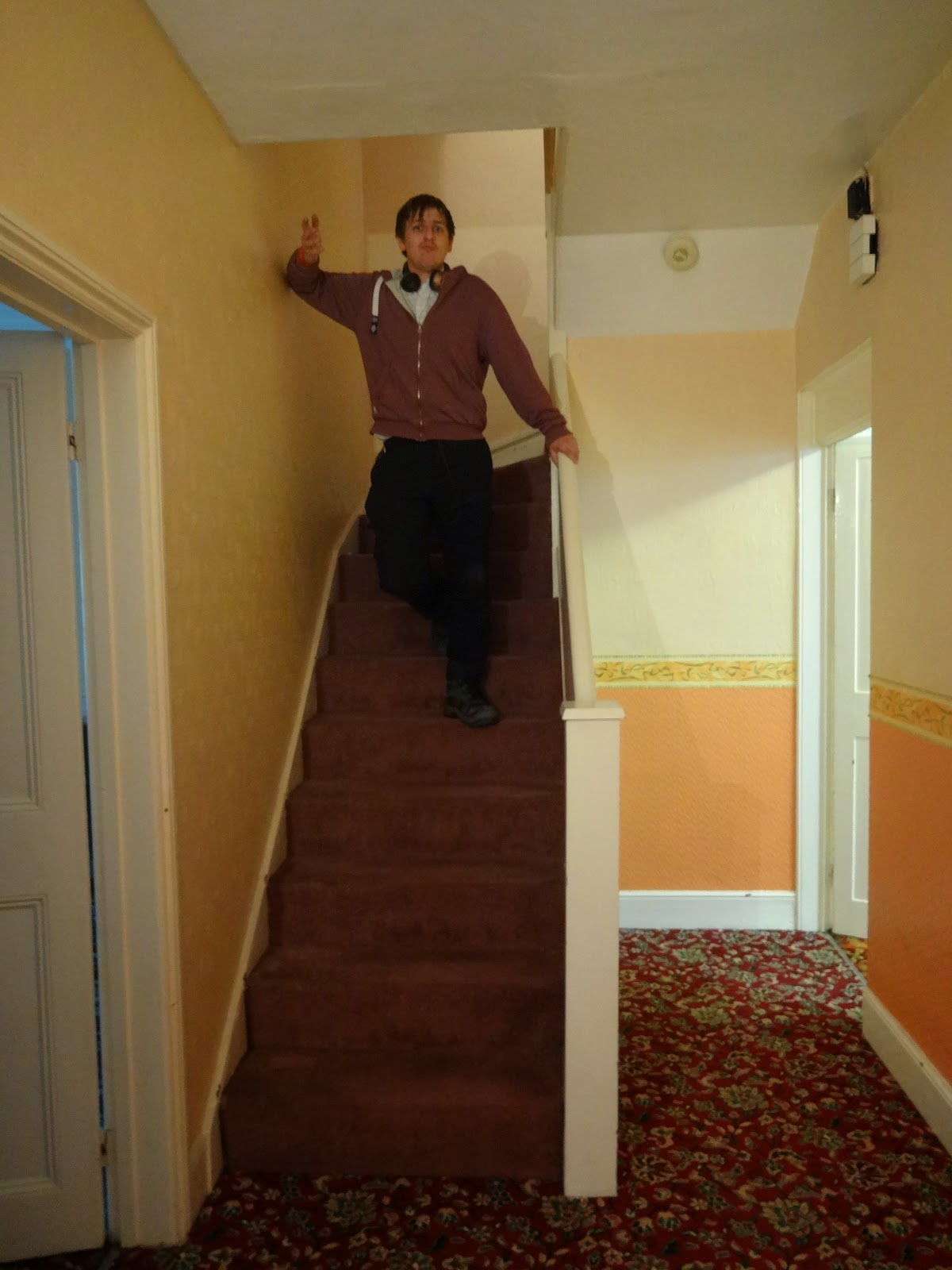 hallway with retro carpet and stairs