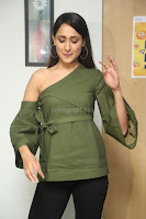 Pragya Jaiswal in a single Sleeves Off Shoulder Green Top Black Leggings promoting JJN Movie at Radio City 10.08.2017 074.JPG