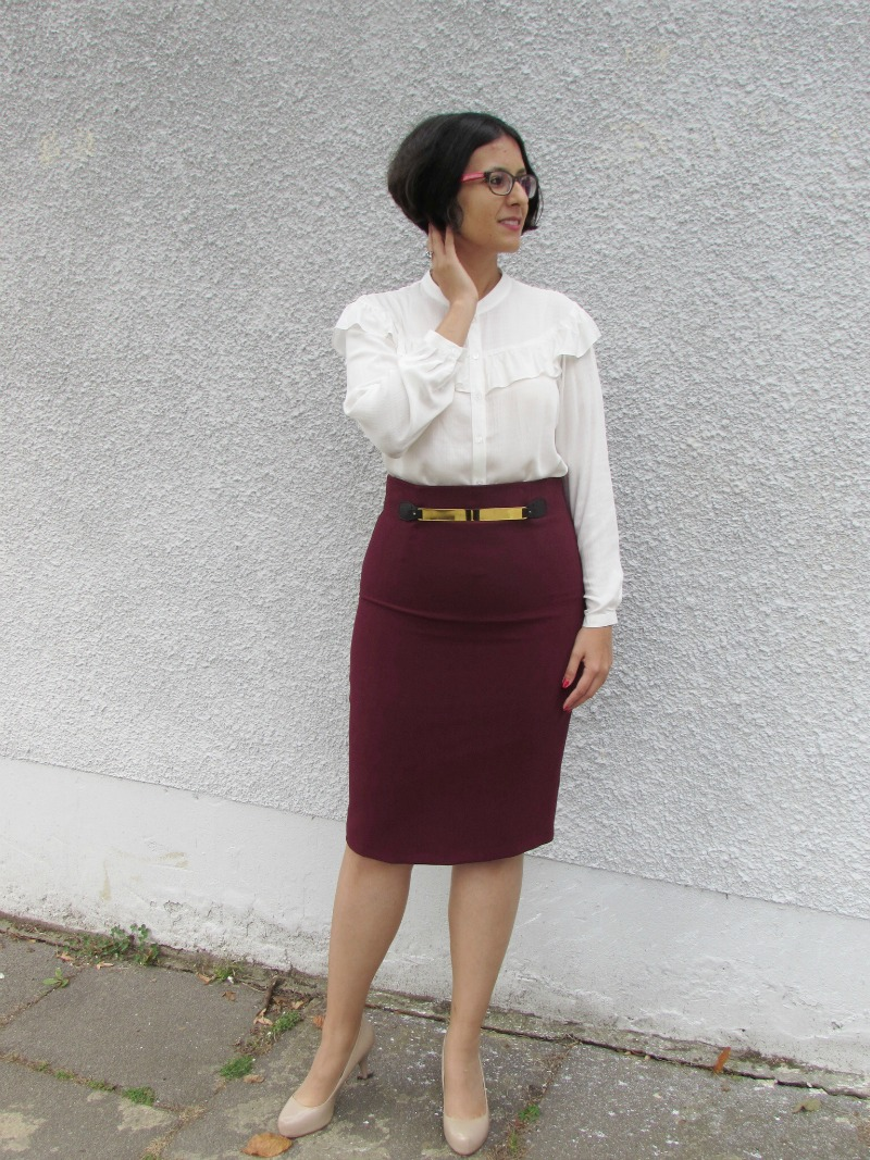 ruffled blouse and pencil skirt
