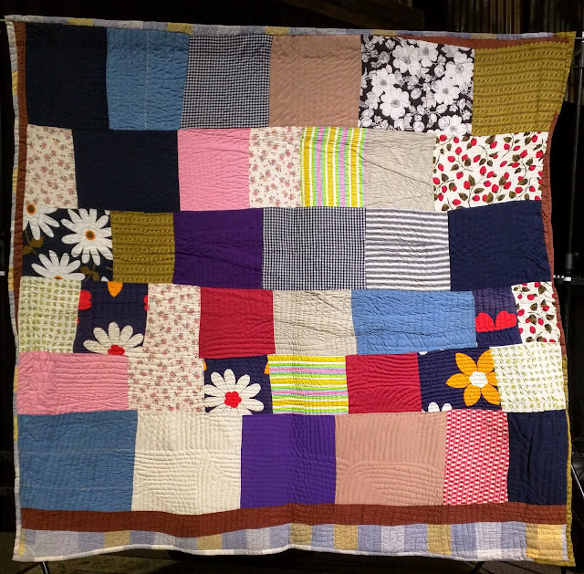 One-patch quilt of randomly sized rectangles.