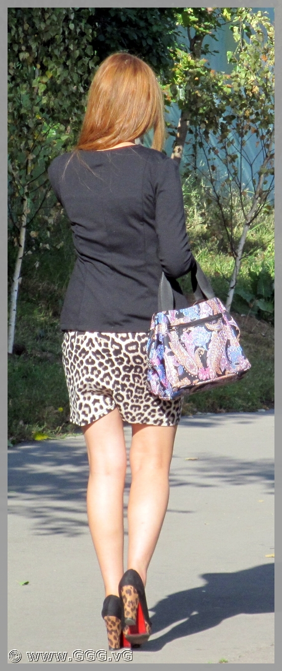 Lady in leopard skirt on high heels