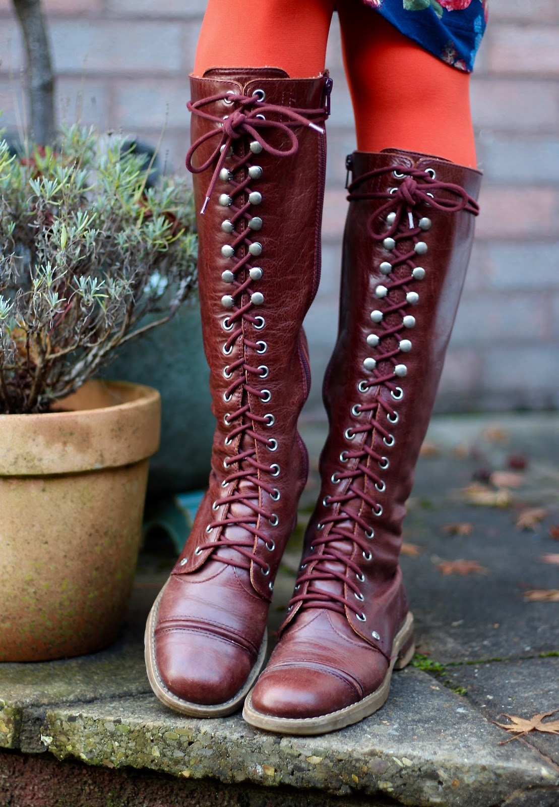 Lace up long boots & orange tights | Fake Fabulous