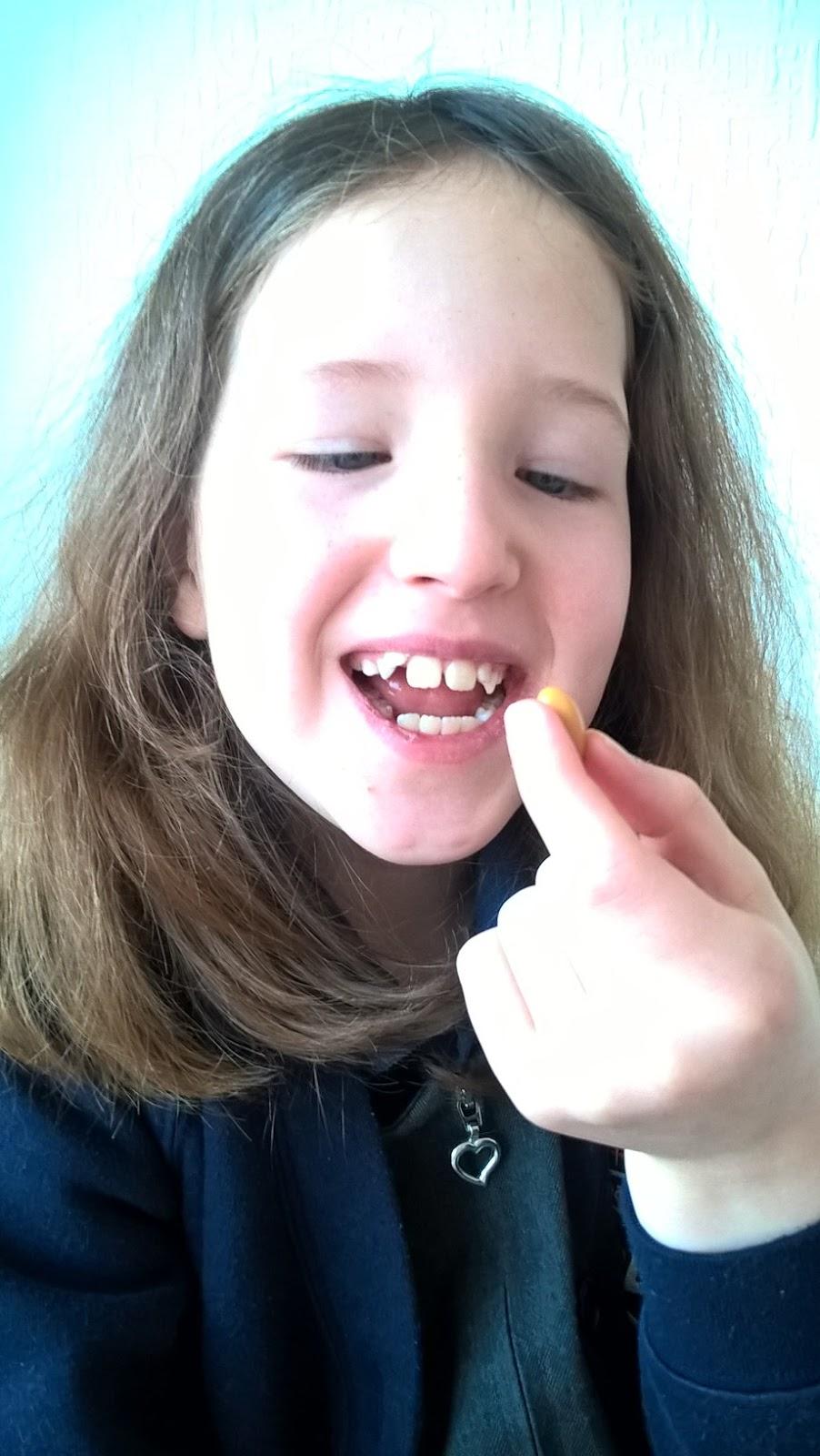 Caitlin Hobbis trying Bioglan SmartKids Brain Formula capsules
