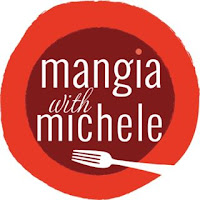 Mangia with Michele red circular logo with white writing and a fork