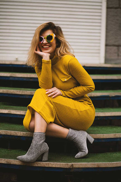 girl wearing yellow dress- cool shades
