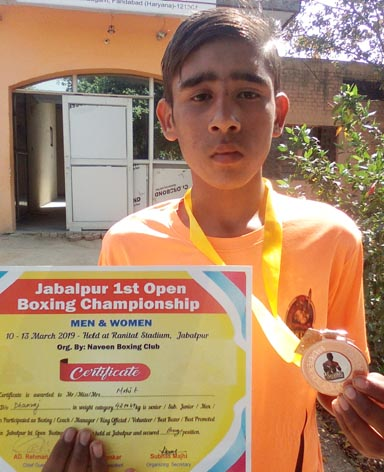 Mohit, the student of Aditya International School in boxing competition, won bronze medal