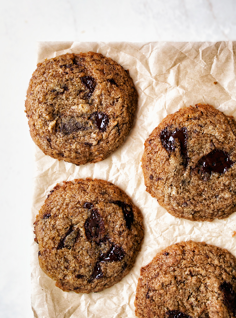 Vegan chocolate chip cookies made with coconut oil, spelt flour, and sweetened with coconut sugar. A healthier version of the classic and made dairy and egg free, these are popular with sugar & butter eaters too.