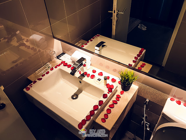 Simple decoration of the toilet with fresh rose flower petals at Ramada KLCC