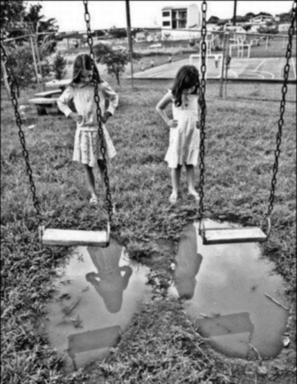 girls-puddle-swing
