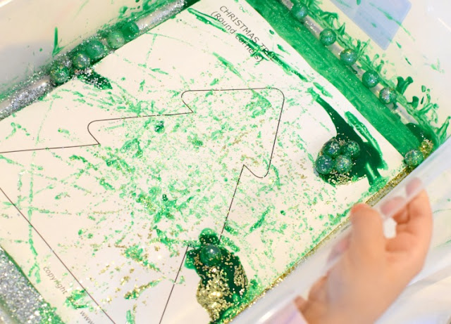 Marble Painted Christmas Tree Craft- easy process art painting activity for preschool, kindergarten, or elementary students.  Leave them plain or decorate with sequins, jewels, and stickers!