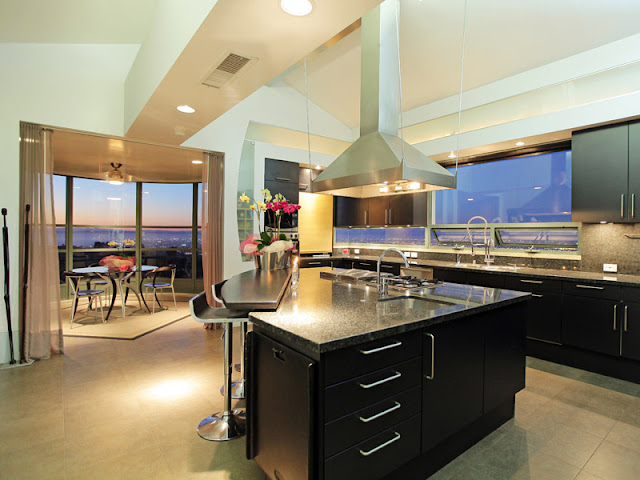 Photo of incredible modern kitchen with triangle shaped kitchen island in the middle