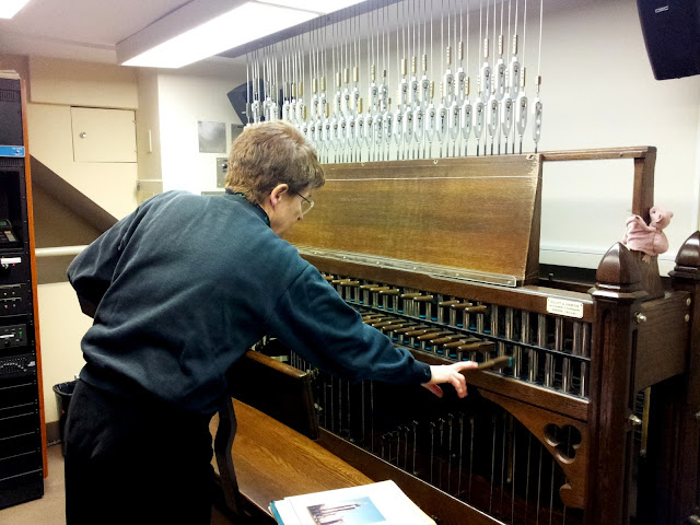 Andrea McCrady, Dominion Carillonneur, tests the tuning of the internal clappers before performance