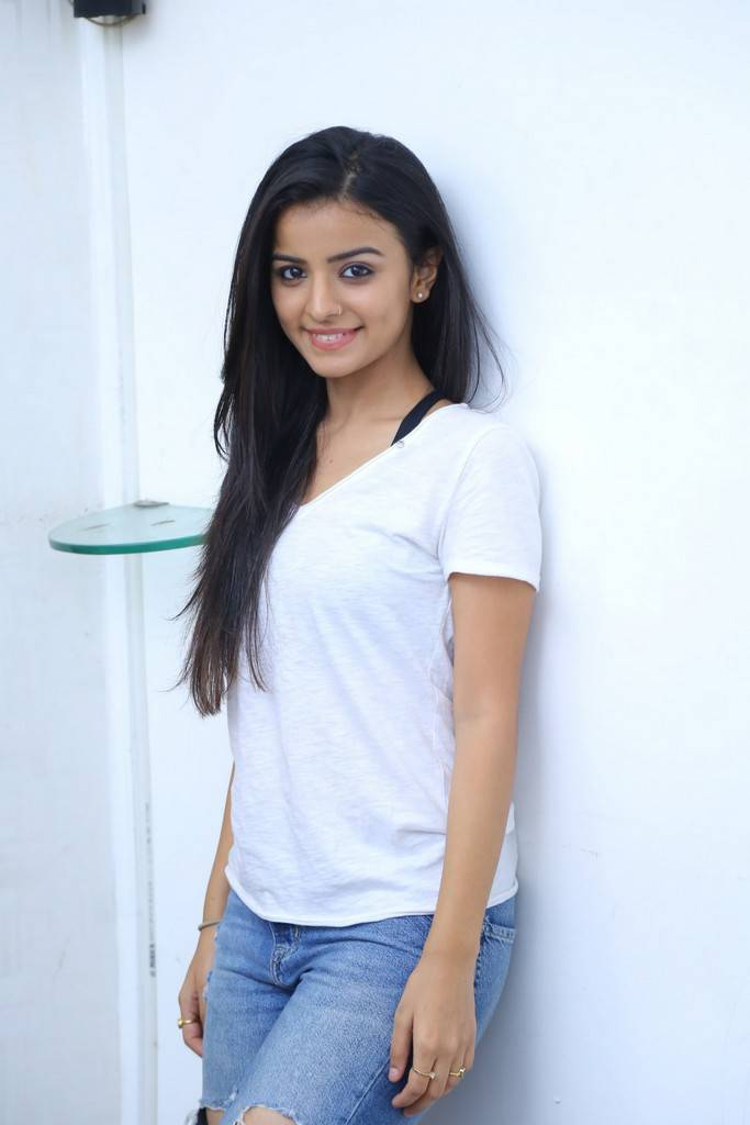 Telugu Girl Mahima Makwana Long Hair Stills In White Top Jeans