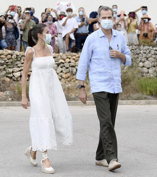 Queen Letizia wore Uterque organza dress with embroidery. Queen Letizia wore a new Macarena espadrille wedges. Queen will also go to Ibiza
