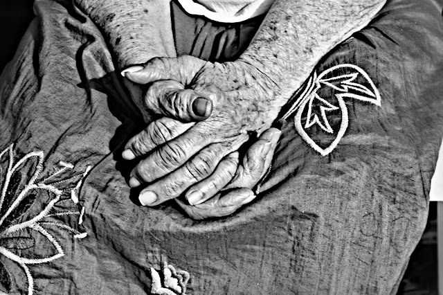 When Mother's Day Hurts - Photo of a woman's hands folded in her lap by RosevineCottageGirls.com