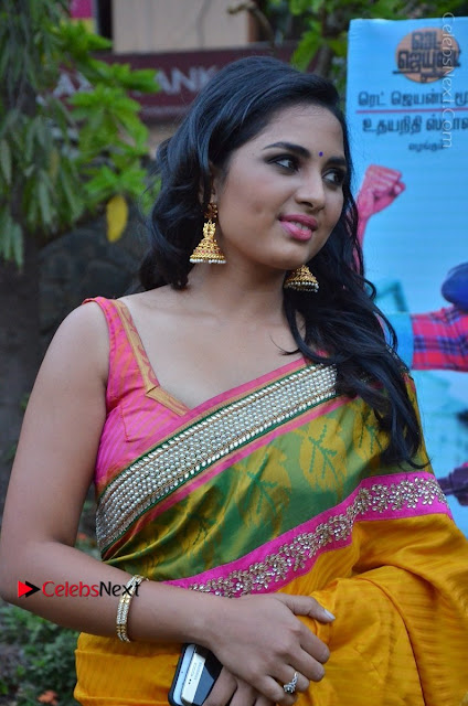 Actress Srushti Dange Latest Pos in Yellow Silk Saree at Saravanan Irukka Bayamaen Tamil Movie Press Meet  0002.jpg