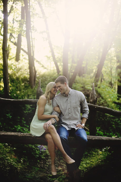 couple on bridge for engagment pictures in sioux city