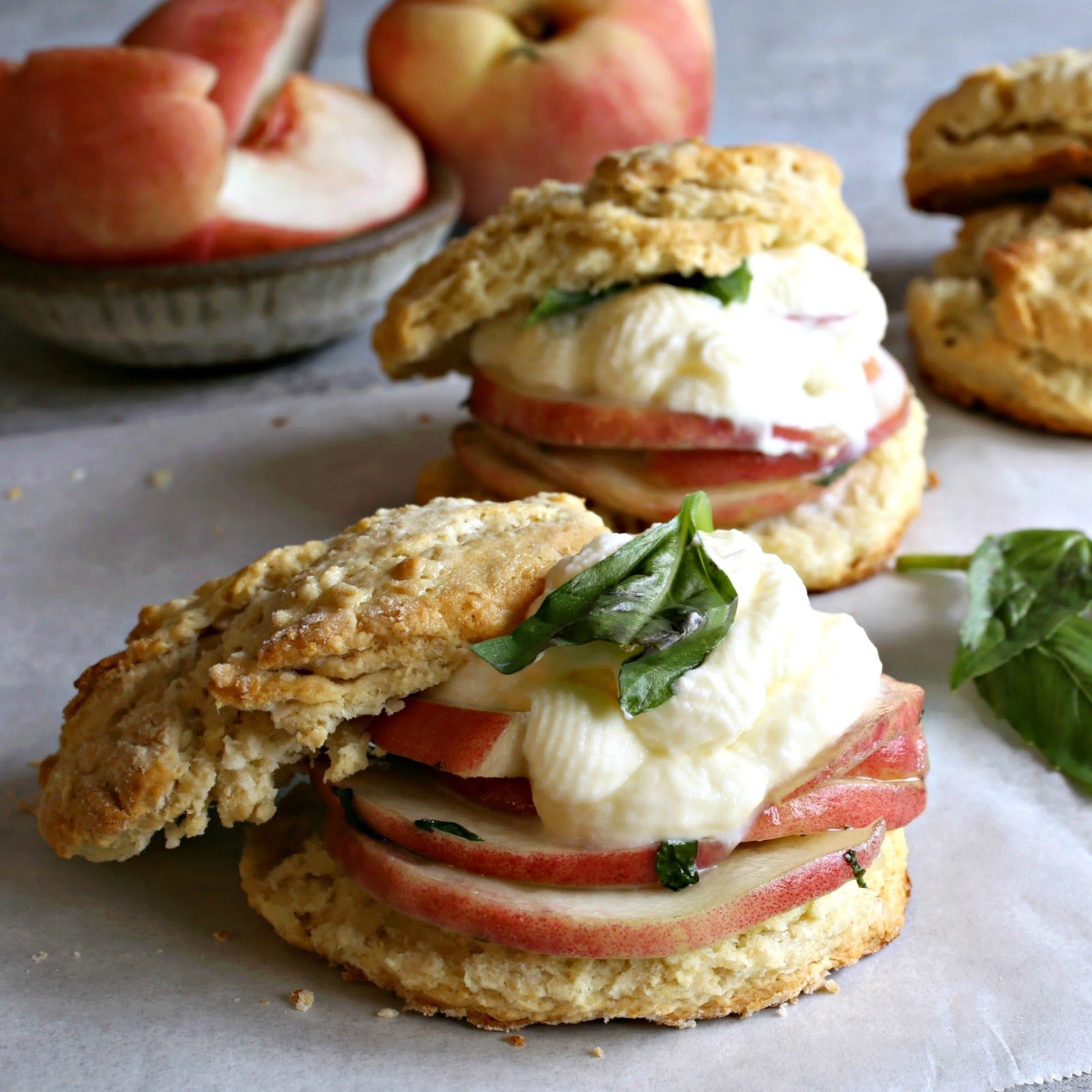 Individual peach shortcakes with sweet buttermilk biscuits and peaches in a honey basil syrup.