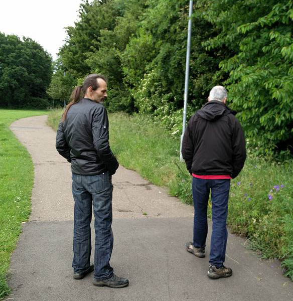 Alex & Roger check out the wild flowers blooming by the sports field adjacent to Mill Crescent, Orton Waterville