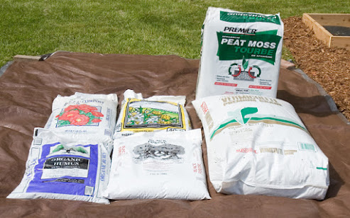 assorted bags of commercial soil