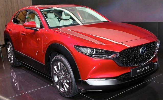 0bd51e6a9b8 A Mazda resistiu em realizar um SUV Coupé ou algo do género. Apesar de ser  mais baixo que o comum