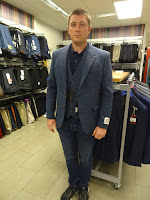 man being fitted for wedding suit