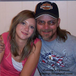 My Daughter Melissa and I sitting with my arm around her