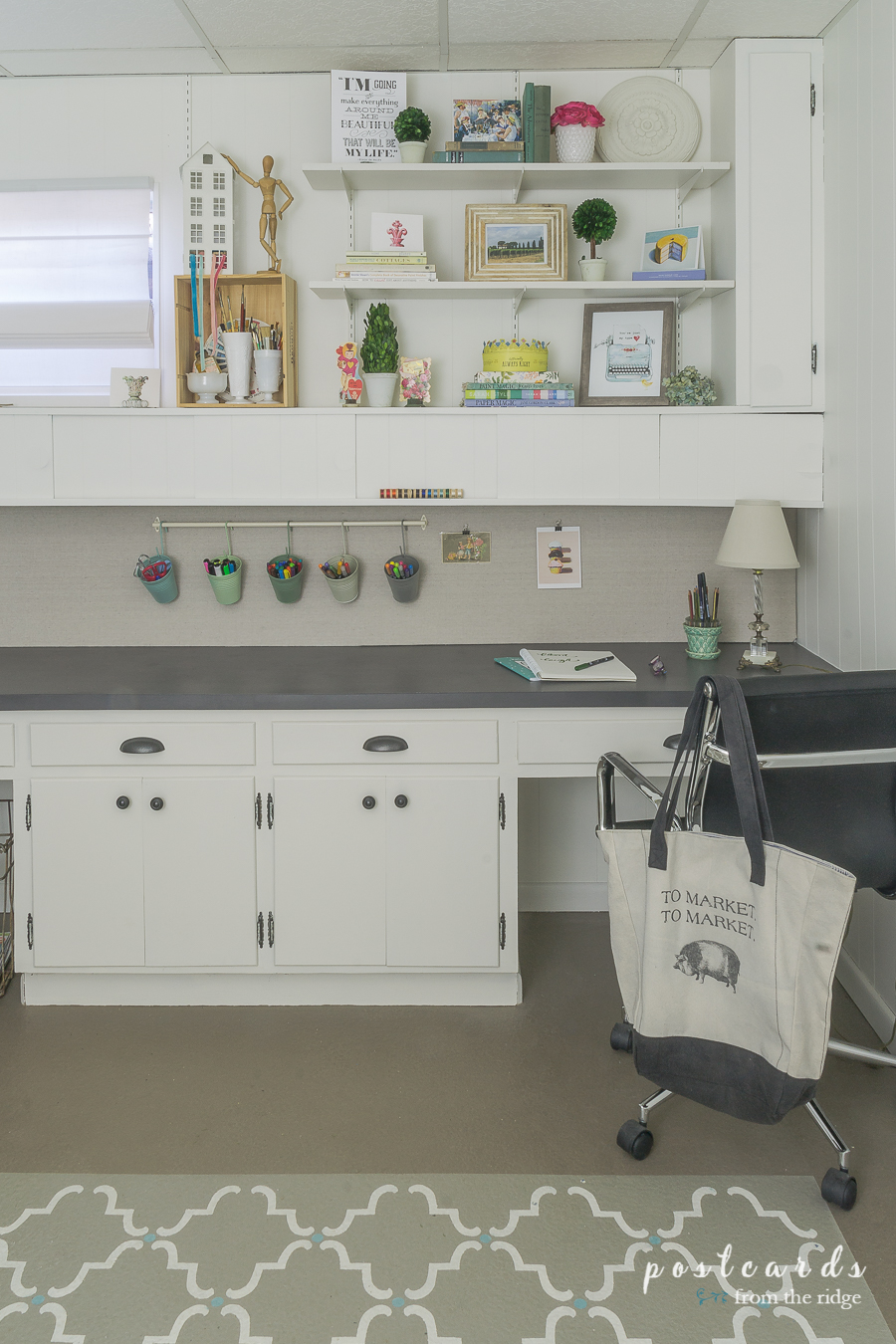 White Cabinets And Shelves With Colorful Accessories In A Studio