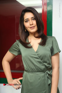 Actress Raashi Khanna Stills in Green Short Dress at Mirchi 95 Suno Aur Mercedes Jeeto Contest  0094.JPG