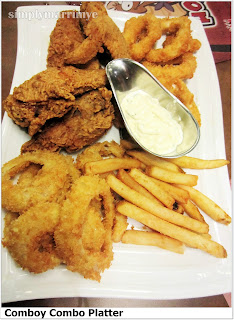 A variety of breaded chicken tenders, onion rings, calamarings and barbecue flavored fries oozing with crispiness and flavors