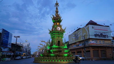 Chiang Rai clock tower lights up in different colors at specific intervals each day