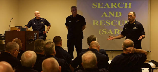 D5NR OTO Clark, J.Morrone, Flotilla 16-08, and BM1 J.Maida, Sta. Manasquan Inlet discuss SAR procedures
