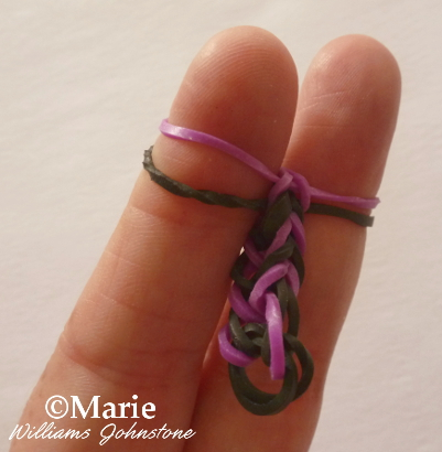 black and purple double fishtail design pattern forming to make a bracelet