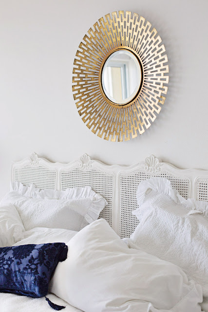 modern gold mirror over bed