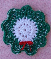 http://www.ravelry.com/patterns/library/christmas-wreath-coaster