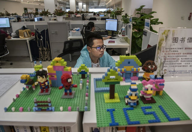 A worker in Huawei's Cyber Security Lab works on his computer at the company's production campus in Dongguan