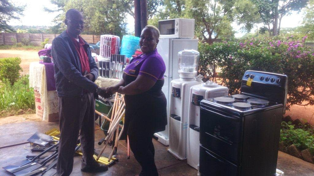 Hollywoodbets Makhado team leader handing over donations to the Rivoni Society principal