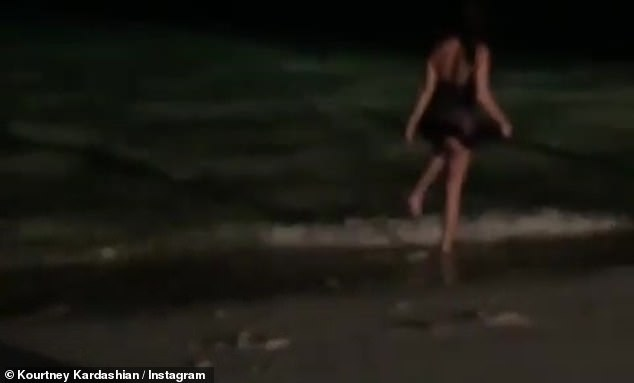 Kourtney Kardashian spotted walking on the shore at night