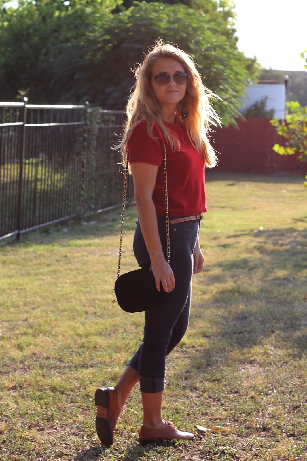 girl wearing red crop top and skinny jeggings with oxfords