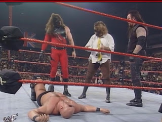 WWE / WWF Capital Carnage 1998 - Mankind, Kane and Undertaker stand over a fallen Stone Cold Steve Austin