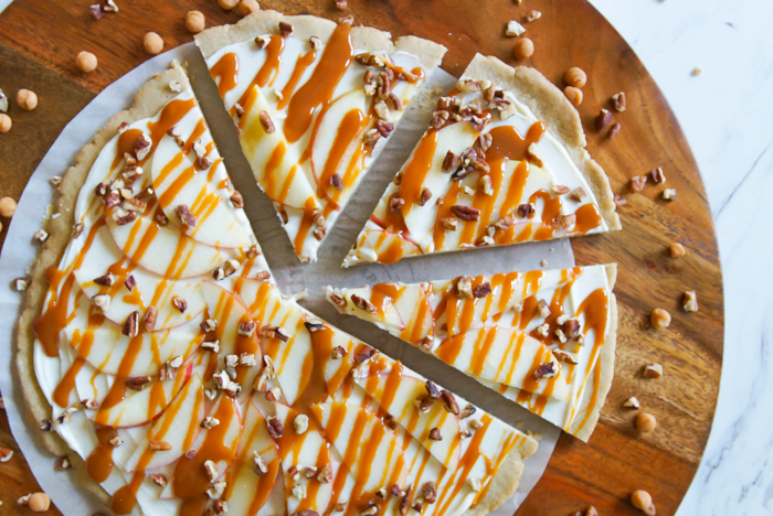 Honeycrisp Caramel Apple Pizza recipe: a spiced cookie crust, cream cheese spread, caramel sauce, toasted pecans, and of course, Honeycrisp apples. | bakeat350.net