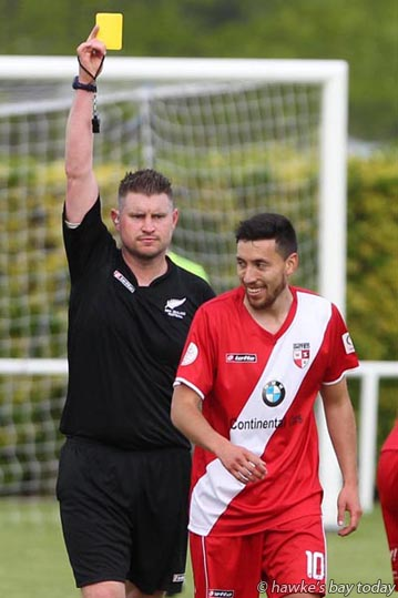 John Rowbury, referee, yellow cards Eder Franchini-Pasten, No 10 Waitakere Rangers - Hawke's Bay United beat Waitakere Rangers 3-1, soccer at Park Island, Napier, opening game in the National Summer League. photograph