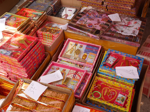 boxes contain a variety of paper replicas including smartphones and jewelry