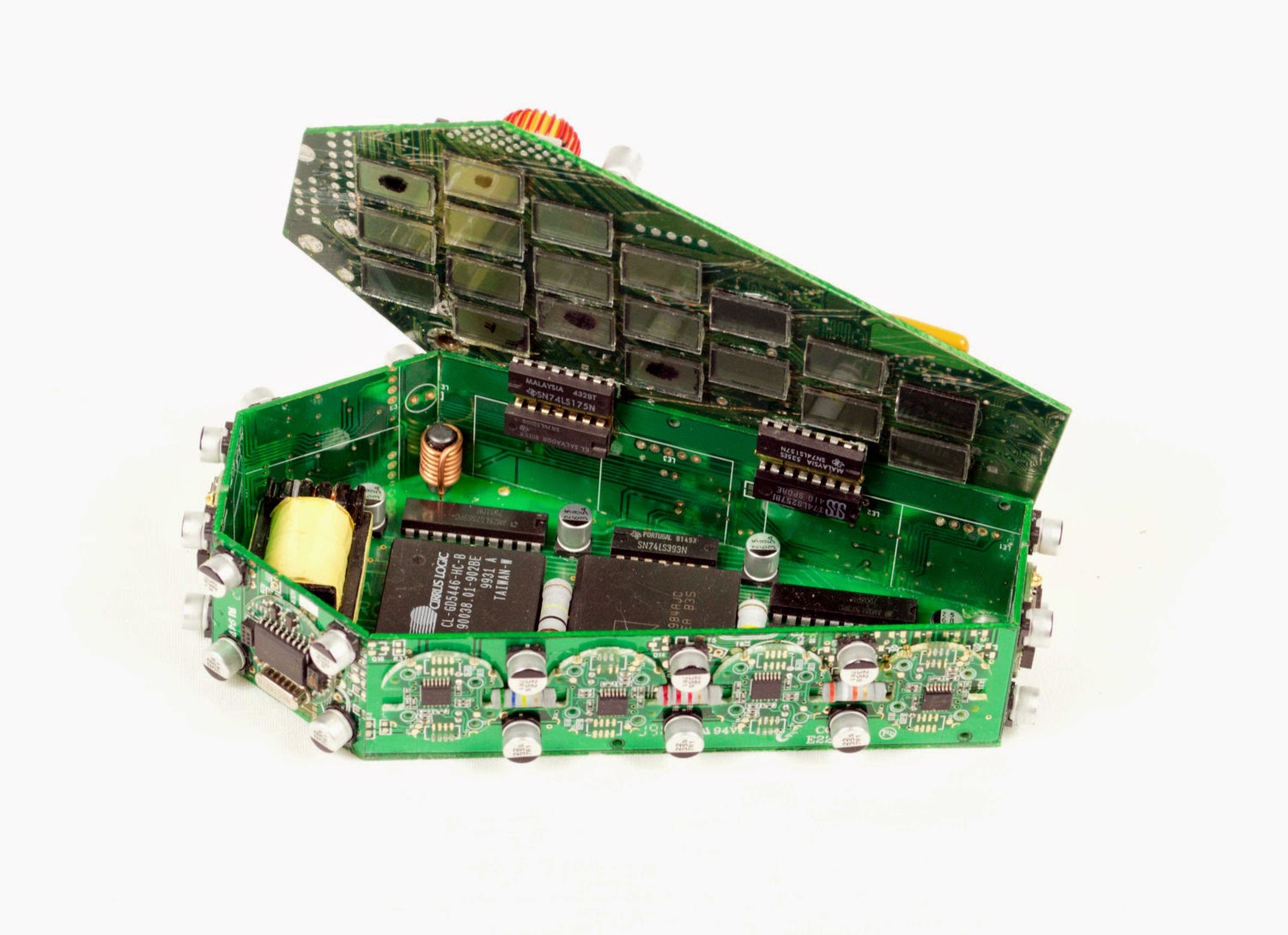 07-Coffin-2-Steven-Rodrig-Upcycle-PCB-Sculptures-from-used-Electronics-www-designstack-co