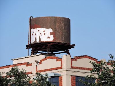 Vintage water tank atop Historic Cheek-Neal Coffee Building