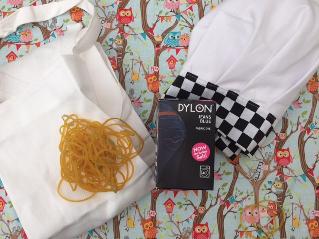 Plain white apron and hat with elastic bands and a box of dylon