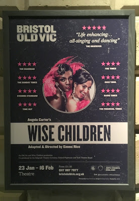 Poster for 'Wise Children' showing 2 showgirls in pink, on a black background showing the lays title and director