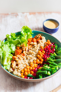 roasted sweet potato, chickpea, quinoa salad with walnuts, pomegranate, broccoli and beans in a mustard date dressing