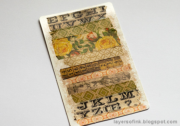 Layers of ink - Embossed Acetate Autumn Tag Tutorial by Anna-Karin Evaldsson, using Tim Holtz Design Tape.